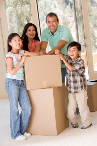 Family with boxes in new home