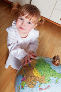 little girl with globe