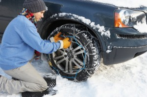 Man Putting Snow Chains on tire