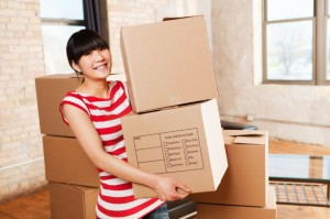Young girl moving in apartment